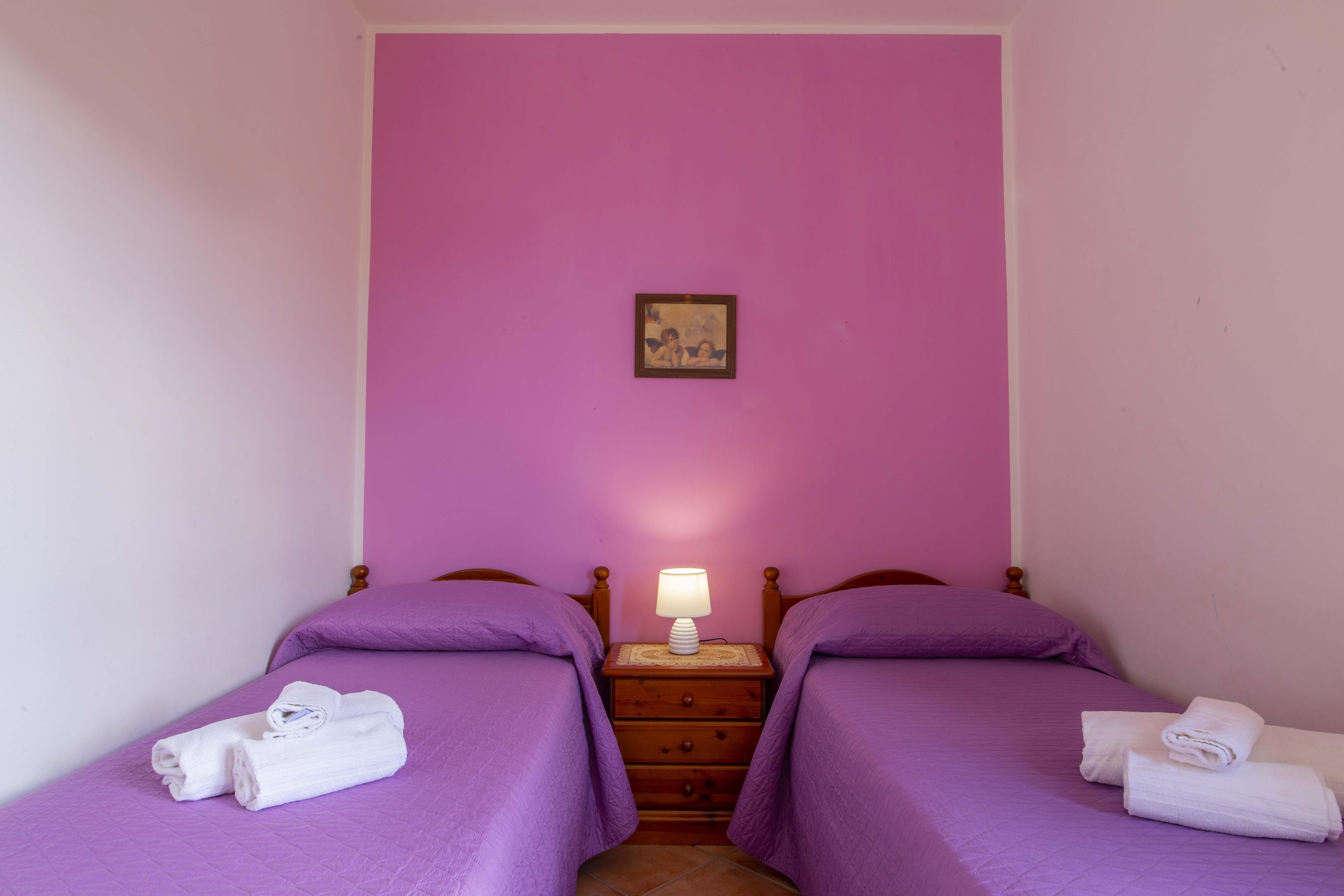 Camera da letto doppia con letti singoli (o matrimoniale)