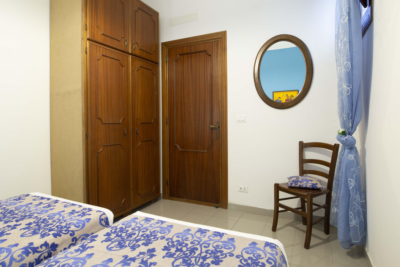 Camera da letto doppia con letti singoli (o matrimoniale) blue